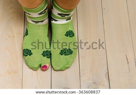 worn out socks with a hole and toe sticking out of them on white Stock photo © art9858