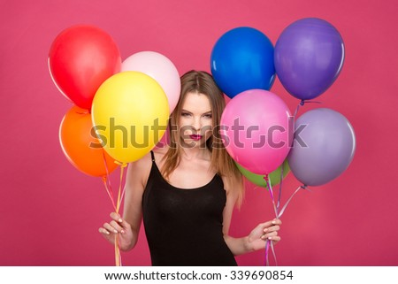 Attractive flirty woman with colorful balloons planning surprise Stock photo © deandrobot