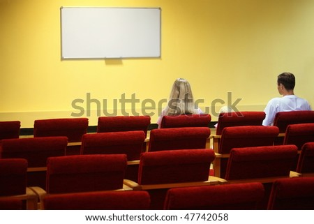 Family in empty presentation hall is waiting start of showtime. screen in out of focus. focus on a w Stock photo © Paha_L