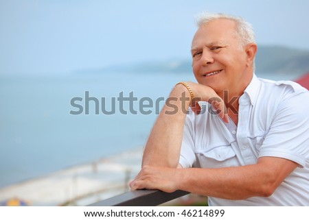 smiling senior on veranda near seacoast, lean elbows about handr Stock photo © Paha_L