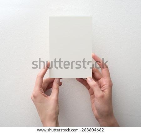 Szürke kártya kéz izolált fehér üzlet Stock fotó © vapi