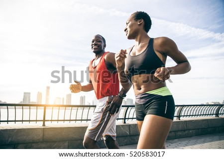 Group of runners on a blue cityscape background, with the page f stock photo © Morphart