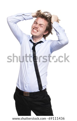 Young man so angry that he wants to pull his hair out Stock photo © filipw