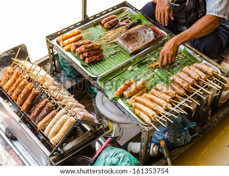 Grilled Thai sausages on the stove in the boat at Traditional Ma Stock photo © Mariusz_Prusaczyk