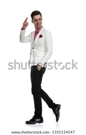 walking businessman looking back over his shoulder while holding stock photo © feedough