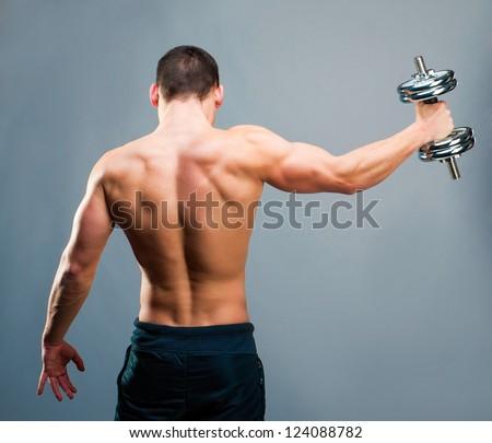 Stok fotoğraf: Genç · erkek · vücut · geliştirmeci · ağır · ağırlık