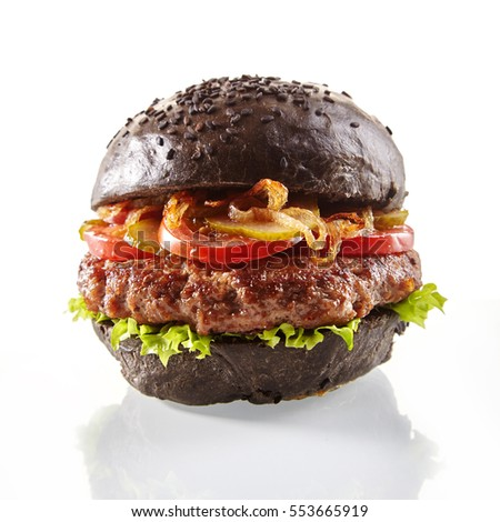 black burger a burger with a black roll slices of juicy marble beef fused cheese fresh salad and stock photo © mcherevan