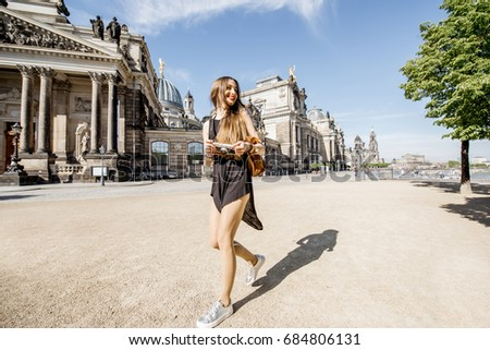 Fine art photo of a beautiful woman in front of a building Stock photo © konradbak