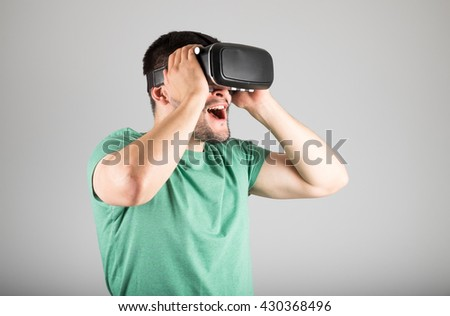 Man with virtual reality goggles watching 3d VR multimedia conte Stock photo © stevanovicigor
