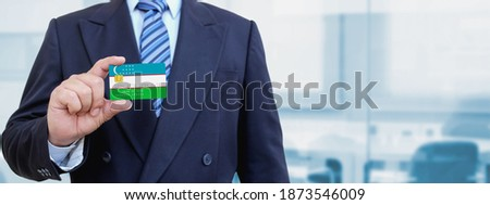 credit card with uzbekistan flag background for bank presentations and business isolated on white stock photo © tkacchuk