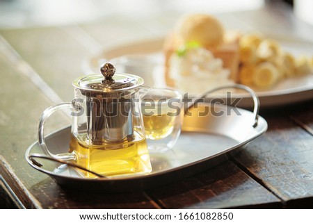 Chinese tea cup and Stainless steel teapot on table for street food of Asia.01 Stock photo © Bigbubblebee99