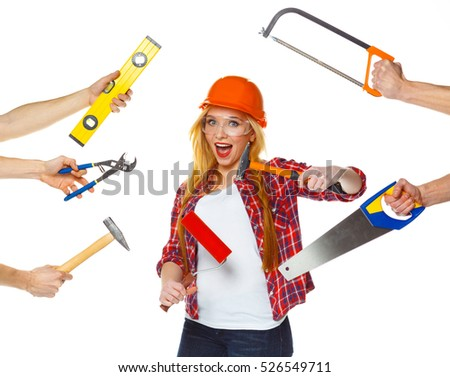funny girl in a helmet with different tools is isolated on the w stock photo © vlad_star