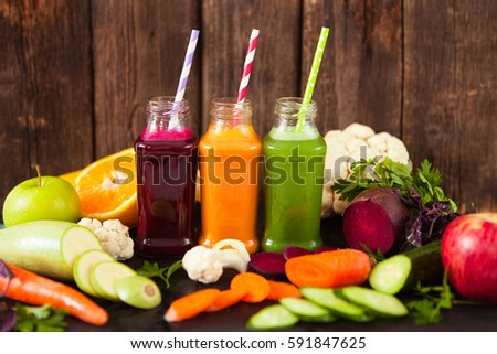 Freshly squeezed vegetable juice in bottles, useful vitamin cock stock photo © Yatsenko