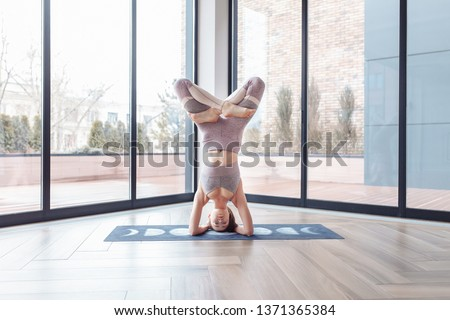 Young concentrated strong fitness lady make stretching exercise Stock photo © deandrobot