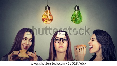 Two happy women eating hamburgers looking at stressed chubby girl with measuring tape around her mou Stock photo © ichiosea