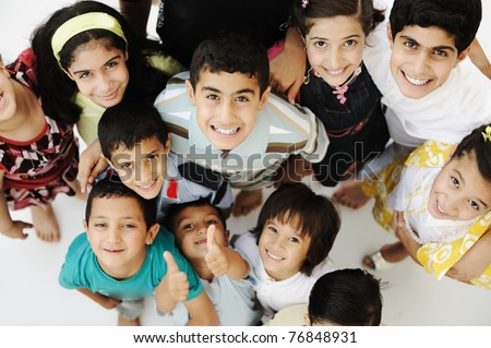 Muslim Kids. Young arab boys and girl standing together and smil Stock photo © NikoDzhi