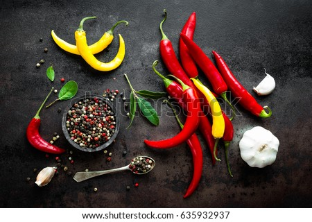 Red hot chili pepeprs and peppercorns on black metal background, top view Stock photo © yelenayemchuk