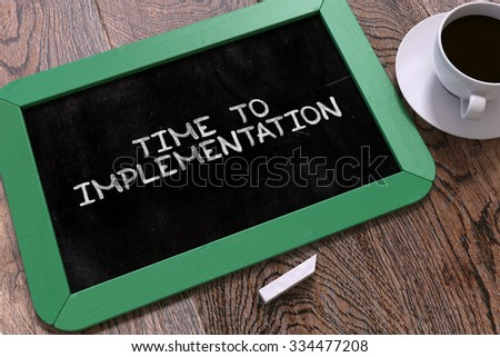 time to implementation handwritten by white chalk on a blackboard stock photo © tashatuvango