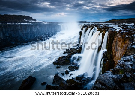 Rapid flow of water powerful Selfoss cascade. Unusual and gorgeo Stock photo © Leonidtit