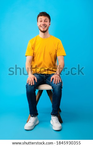 Full-length portrait of pleased man with stubble standing with h Stock photo © deandrobot