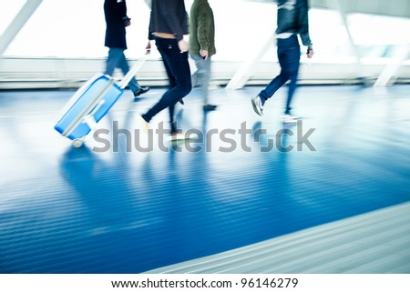 airport rush people with their suitcases walking along a corrid stock photo © lightpoet