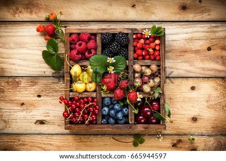 fresh raw organic blueberries in vintage wooden box on stone kitchen background macro stock photo © denismart