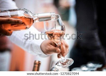 Bottles of red white and pink rose wine with glasses and corkscrew opener on stone kitchen table bac Stock photo © DenisMArt