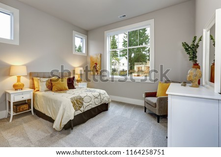 guest modern bedroom interior with grey walls and orange pillows stock photo © iriana88w