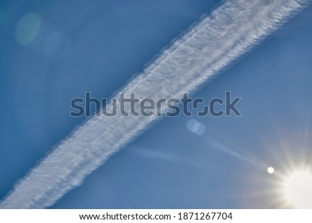 white condensation trail from a jet as it flies across a blue sk stock photo © monkey_business