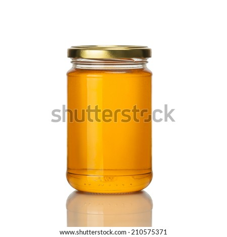 Sweet dessert - organic natural honey in a glass jar with wooden stick on a gray stone table. Jewish Stock photo © artjazz