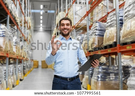 businessman with clipboard at warehouse showing ok Stock photo © dolgachov