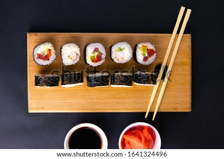 Sushi Set. Different kinds of sushi rolls on wooden serving board Stock photo © dash