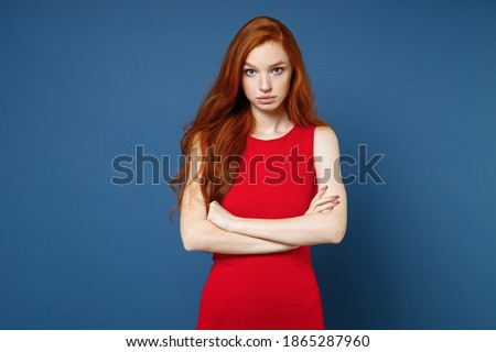 Image of displeased woman 20s wearing red dress holding chocolat Stock photo © deandrobot