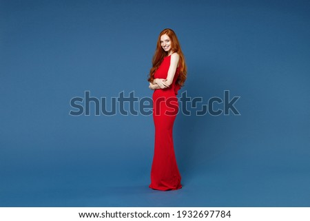 image of elegant woman 20s wearing red dress holding chocolate b stock photo © deandrobot