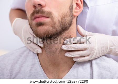Doctor Performing Physical Exam Palpation Of The Thyroid Gland Stock photo © AndreyPopov