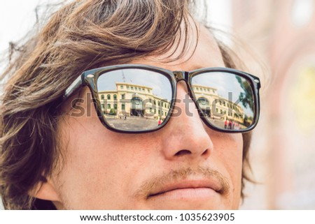 A man looks at Saigon Central Post Office on blue sky background in Ho Chi Minh, Vietnam. Steel stru Stock photo © galitskaya