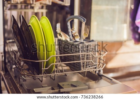 dishwasher with dirty dishes powder dishwashing tablet and rinse aid washing dishes in the kitche stock photo © galitskaya