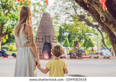 mother and son tourists look at wat chalong is the most important temple of phuket stock photo © galitskaya