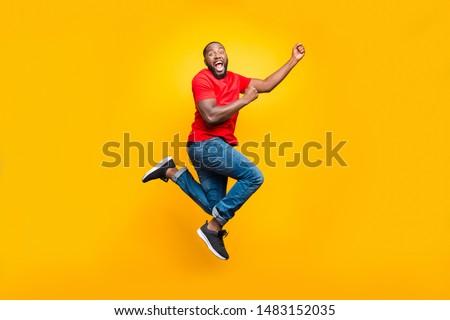 Full length photo of happy african man having stylish afro haird Stock photo © deandrobot