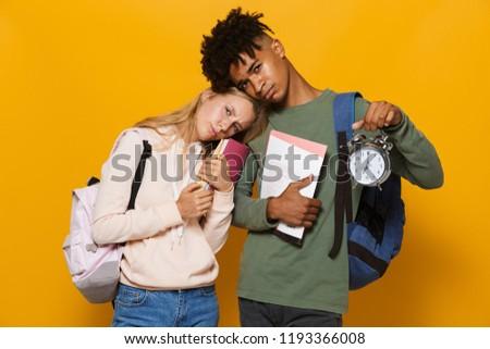 Foto deluso studenti uomo donna indossare Foto d'archivio © deandrobot