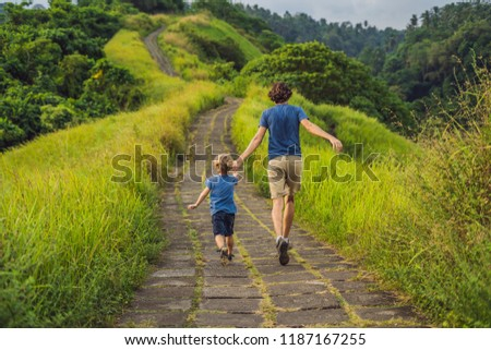 Dad and son tourists in Campuhan Ridge Walk , Scenic Green Valley in Ubud Bali. Traveling with child Stock photo © galitskaya