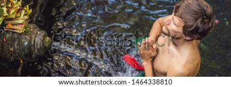 Man in holy spring water temple in bali. The temple compound consists of a petirtaan or bathing stru Stock photo © galitskaya