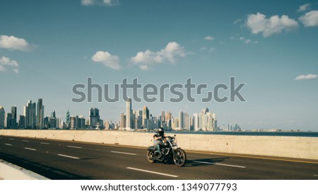 Man Riding Motorcycle in Panama City With Skyline in Background Stock photo © diego_cervo