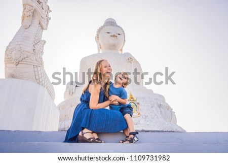 mother and son tourists on the big buddha statue was built on a high hilltop of phuket thailand can stock photo © galitskaya