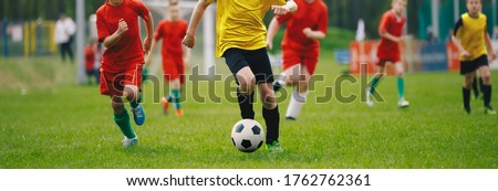 Junior Soccer Teams During Running Duel. Football Game For Youth Stock photo © matimix