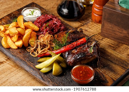 Steak pork grill on wooden cutting board with a variety of grilled vegetables Stock fotó © Illia