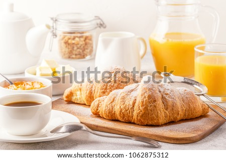 Breakfast with croissant, coffee, strawberry and jam on the plat Stock photo © dashapetrenko