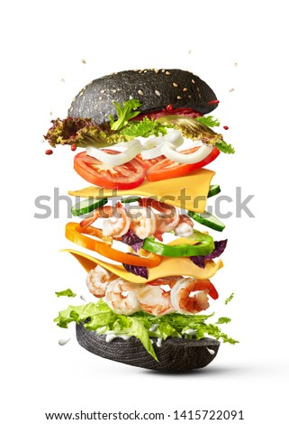 Flying burger with shrimp and fresh vegetables on a white backgr Stock photo © artjazz