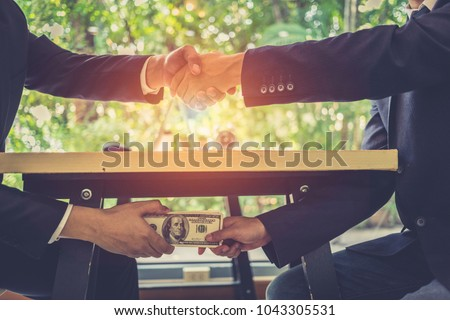 bribe and corruption concept corrupted businessman sealing the stock photo © snowing