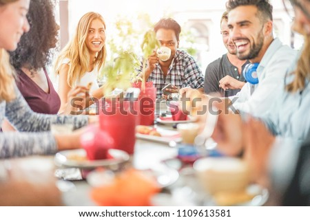 young happy women friends drinking coffee eating croissant while using laptop computer stock photo © deandrobot